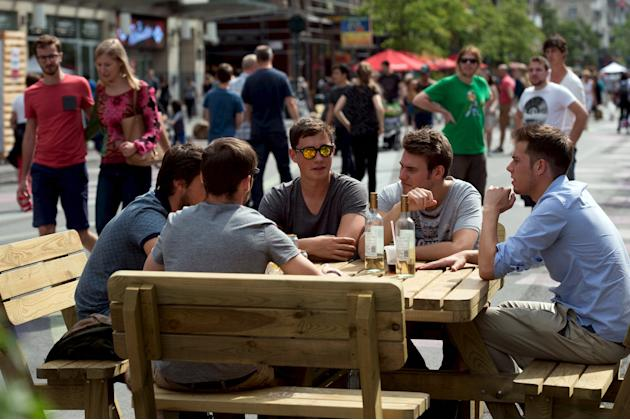 People sit at a table in the pedestrian area in Brussels