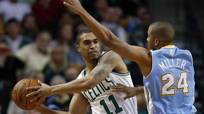 Boston Celtics' Courtney Lee (11) keeps the ball away from Denver Nuggets' Andre Miller (24) in the second quarter of an NBA basketball game in Boston, Friday, Dec. 6, 2013
