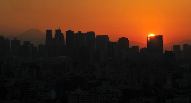 This file photo shows a general view of skyscrapers dotting the skyline of Shinjuku district in Tokyo at sunset on October 21, 2012. A Japanese teenager who allegedly killed his mother and chopped her body into pieces has told police he simply did not like her, and wanted to know more about dissection, according to reports