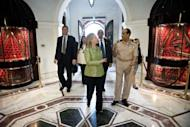 Field Marshal Mohamed Tantawi walks with US Secretary of State Hillary Clinton to a meeting at the Ministry of Defense in Cairo, Egypt. Clinton met Sunday with Egypt's top military leaders, urging them to support a transition to civilian rule as a political struggle triggers fears that rights could be eroded