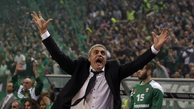 Panathinaikos' coach Argiris Pedoulakis reacts after a referee's decision during a Euroleague basketball match of Top 16 against Olympiakos at the Olympic Indoor Arena in Athens, Thursday, Feb. 20, 2014. Panathinaikos won 66-62. (AP Photo/Thanassis Stavrakis)
