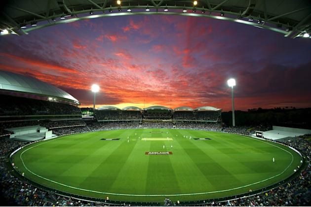 New Zealand's Tim Southee bowls as the sun sets during the first day of the third cricket test match against Australia at the Adelaide Oval, in South Australia