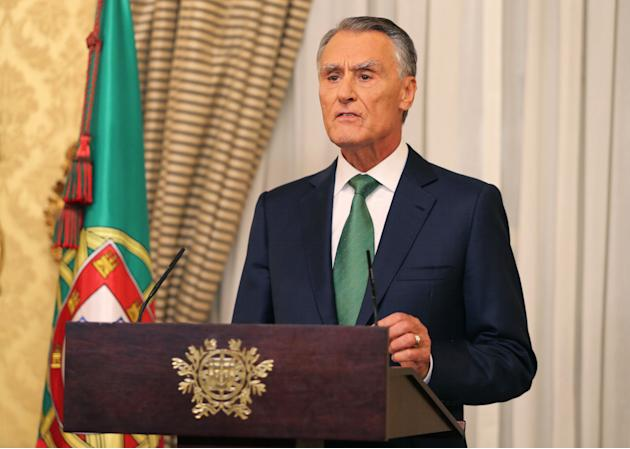 FILE - In this Tuesday, Oct. 6 2015 file photo, Portuguese President Anibal Cavaco Silva addresses the country after his meeting with Prime Minister Pedro Passos Coelho at the Belem presidential palac