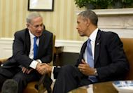 US President Barack Obama shakes hands with Israeli Prime Minister Benjamin Netanyahu in the Oval Office of the White House in Washington