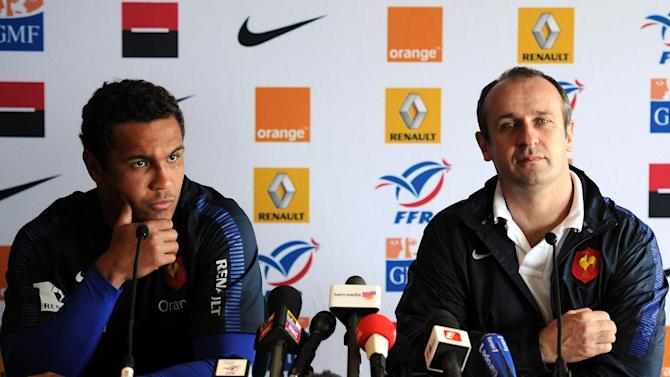 France's rugby union national team captain Thierry Dusautoir (L) and head coach Philippe Saint Andre (R) attend a press conference in Cardiff on March 16, 2012 on the eve of the rugby union 6 Nations' match between Wales and France. AFP PHOTO / FRANCK FIFE (Photo credit should read FRANCK FIFE/AFP/Getty Images)