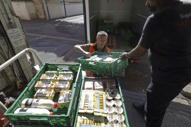 A volunteer at the Food Bank transfers food donated by a supermarket to charity in France. (Reuters)