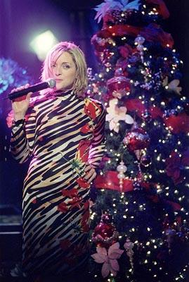 "Elaine (Jane Krakowski) delivers some holiday spirit with her rendition of ""Rocking Around The Christmas Tree"" on ""The Man With The Bag"" episode of Ally McBeal Ally McBeal"
