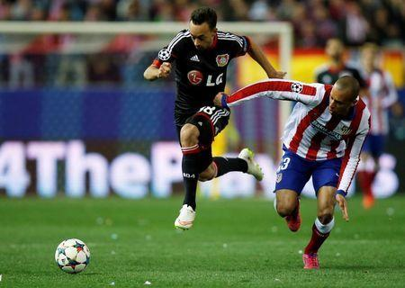 Bayer Leverkusen's Bellarabi is challenged by Atletico Madrid's Miranda during their Champions League round of 16 second leg soccer match in Madrid