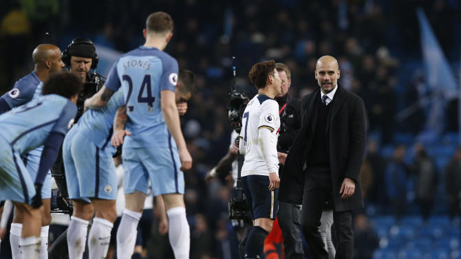Manchester City manager Pep Guardiola and Tottenham's Son Heung-min after the match
