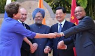 (L-R) Brazilian President Dilma Roussef, Russian President Vladimir Putin, Indian Prime Minister Manmohan Singh, Chinese President Hu Jintao and South African President Jacob Zuma pose for group photo in Los Cabos, Mexico, during a BRICS presidents meeting before the opening of the G20 leaders Summit