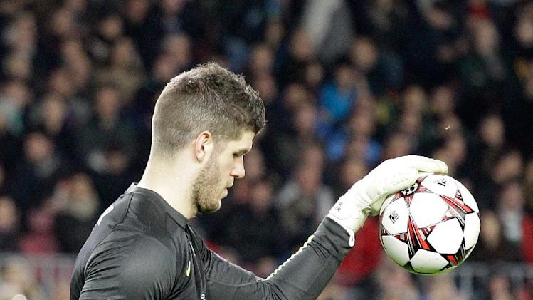 Celtic goalkeeper Fraser Forster reacts after Barcelona scored the 6th goal during a Group H Champions League soccer match between FC Barcelona and Celtic FC at the Camp Nou stadium in Barcelona, Spain, Wednesday Dec. 11, 2013