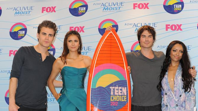 From left, Paul Wesley, Nina Dobrev, Ian Somerhalder and Kat Graham, winners of the award for best TV show: sci-fi/fantasy for Vampire Diaries pose backstage at the Teen Choice Awards on Sunday, July 22, 2012, in Universal City, Calif. (Photo by Jordan Strauss/Invision/AP)