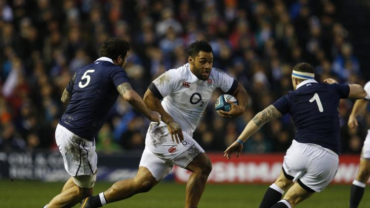 England's Billy Vunipola is challenged by by Scotland's Jim Hamilton and Ryan Grant during their Six Nations rugby union match at Murrayfield Stadium in Edinburgh