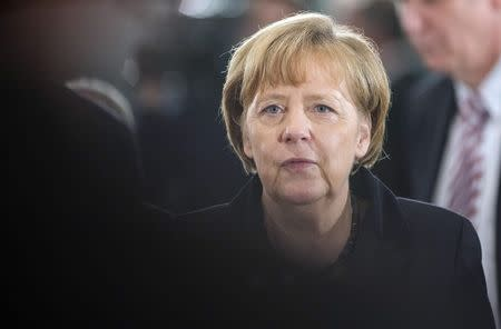 German Chancellor Angela Merkel arrives for a meeting of German state leaders at the chancellery in Berlin December 11, 2014. REUTERS/Hannibal Hanschke