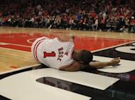 Derrick Rose of the Chicago Bulls lays on the floor after suffering an injury against the Philadelphia 76ers in Game One of the Eastern Conference quarter-finals during the 2012 NBA Playoffs on April 28. The Bulls won 103-91