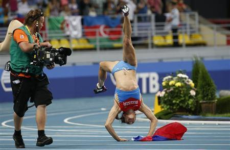 Isinbayeva of Russia celebrates after winning women's pole vault final at World Athletics Championships in Moscow