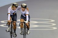Germany's Kristina Vogel (R) and Germany's Miriam Welte celebrate after winning the Women's team sprint gold final as part of the track cycling event of London 2012 Olympic games, at the ExCel centre in London. Germany were crowned inaugural Olympic women's team sprint champions in controversial fashion following the relegation of China at the velodrome Thursday