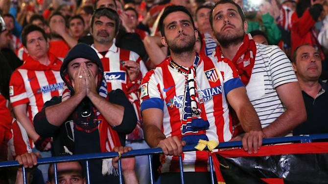 Champions League - Beaten Atletico face tough task to stay at top