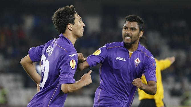 Fiorentina's Ryder Matos, left,  celebrates with teammate Marko Momcilovic, right, after scoring an equalizer during an Europa League, group E match, between Fiorentina and Pandurii, at the Cluj Arena stadium in Cluj, Romania, Thursday, Nov. 7,  2013