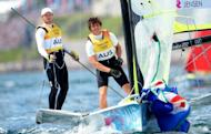 Australia's Nathan Outteridge (left) and Iain Jensen cross the line to win gold in the 49er sailing class at the London 2012 Olympic Games in Weymouth. Outteridge and Jensen won the men's 49er gold at the London Olympics, giving Australia a second sailing gold of the Games