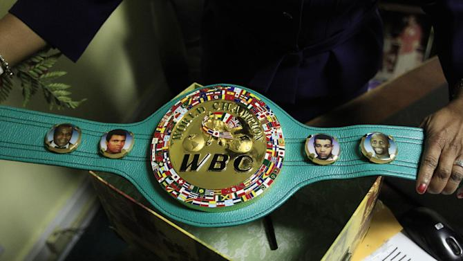 Emanuel Steward's sister Sylvia Steward-Williams holds a championship belt created by the World Boxing Council (WBC) honoring, from left, Emanuel Steward, Muhammad Ali, Joe Louis and Thomas Hearns at the trainer's office in Detroit, Tuesday, Nov. 13, 2012. A funeral service for late boxing trainer Emanuel Steward was held Tuesday in Detroit. (AP Photo/Carlos Osorio)