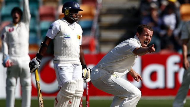 Cricket - Australia captain Clarke injured as Sri Lanka chase 393