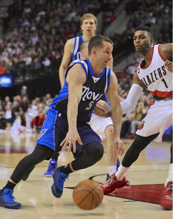 Dallas Mavericks' Jose Juan Barea (5) drives against Portland Trail Blazers' Dorell Wright (1) during the first half of an NBA basketball game in Portland, Ore., Thursday, March 5, 2015. (AP P