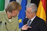 German Chancellor Angela Merkel speaks to Italian Prime Minister Mario Monti at the end of a joint press conference at Villa Madama in Rome. The leaders of the eurozone's four biggest economies on Friday vowed measures to boost growth in the face of a relentless debt crisis, including an injection of up to 130 billion euros ($163 billion)