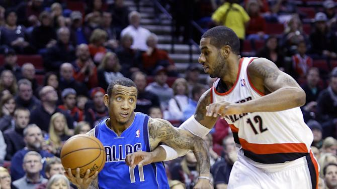 Dallas Mavericks guard Monta Ellis, left, drives to the basket against Portland Trail Blazers forward LaMarcus Aldridge during the first half of an NBA basketball game in Portland, Ore., Saturday, Dec. 7, 2013
