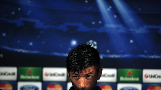 Porto's captain Lucho Gonzalez listens to the questions of journalists during a news conference after their training session at Dragon stadium in Porto