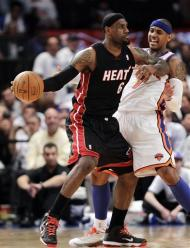 Miami Heat forward LeBron James, left, posts up on New York Knicks forward Carmelo Anthony during the first half of Game 3 of an NBA basketball first-round playoff series at Madison Square Garden in New York, Thursday, May 3, 2012. (AP Photo/Kathy Willens)
