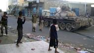 Yemeni armed tribesmen ride a tank in the southern town of Loder on Saturday. At least 222 people including 183 militants have been killed in five days of clashes around the strategic south Yemen town of Loder which Al-Qaeda is trying to seize, a security official says