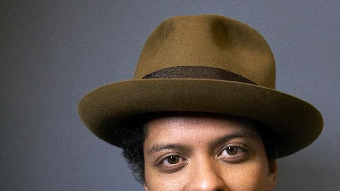 "American singer-songwriter and record producer Bruno Mars, born Peter Gene Hernandez, poses for a portrait on Monday, Nov. 5, 2012 in New York. Mars' recent appearance on ""Saturday Night Live"" was more like Saturday Night Fever: He says he had so much fun hosting the show that he'd be happy to do it again. ""Whatever 'SNL' wants from me, they can always call me,"" the smiling 27-year-old said in an interview Wednesday afternoon. ""I don't know who told them I can act or anything 'cause I can't. I don't know what they saw. (But) whatever they need from me, they can get.""  (Photo by Dan Hallman/Invision/AP)"