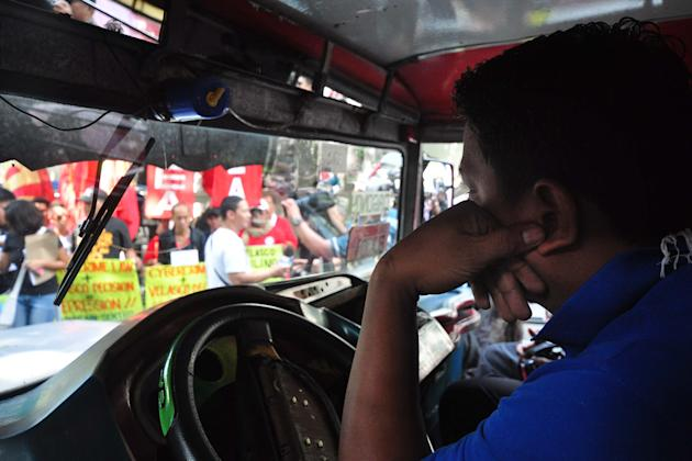A driver got his jeepney stuck in the middle of the protest during the anti Cybercrime Law protest. (George Calvelo/NPPA Images)