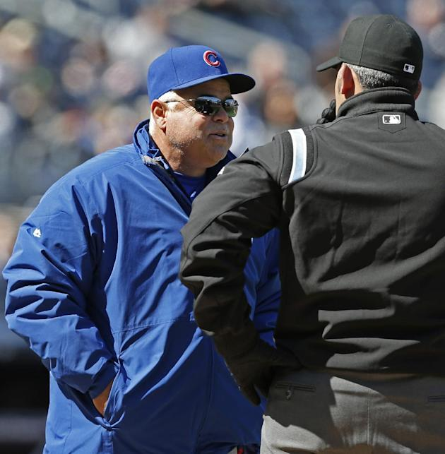 Chicago Cubs manager Rick Renteria challenges a force play at first by asking for a video review from first base umpire Manny Gonzalez in the seventh inning of Game 1 of an interleague baseball double