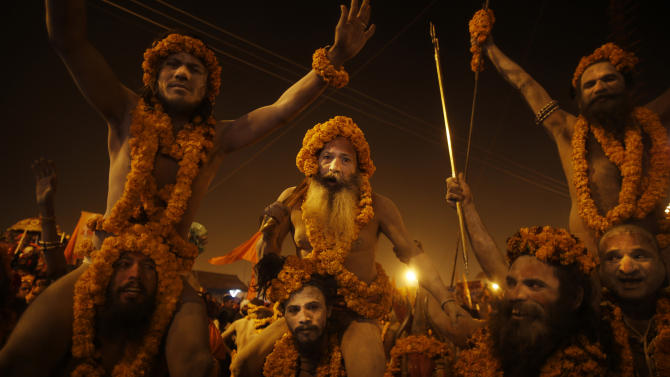 """Naga"" sadhus or Hindu naked holy men from the Niranjani ""Akhada"" or sect, take out a procession to take a ritual dip at ""Sangam,"" the confluence of Hindu holy rivers Ganges, Yamuna and the mythical Saraswati, during the Maha Kumbh festival at Allahabad, India, Sunday, Feb. 10, 2013. Millions of devout Hindus and thousands of Hindu holy men are expected to take a dip at Sangam on Sunday, the most auspicious day according to the alignment of stars, for the entire duration of Maha Kumbh festival, which lasts for 55 days. (AP Photo/ Saurabh Das)"