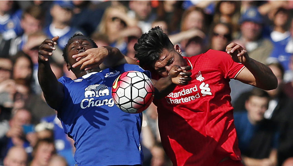 Liverpool's Emre Can in action with Everton's Romelu Lukaku