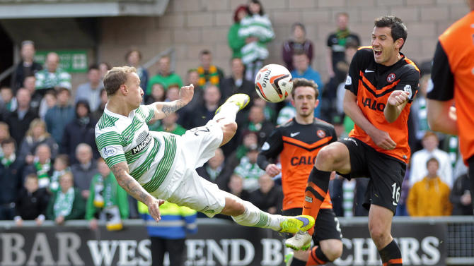 Football: Dundee United's Ryan McGowan (R)  in action with Celtic's Leigh Griffiths
