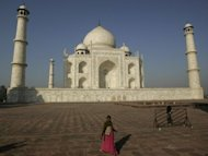 An Indian tourist walks past the UNESCO World Heritage site Taj Mahal in Agra in 2011. A replica of India's world-famous Taj Mahal, four times the size of the original, is to be built in Dubai as what is to be billed as the world's grandest wedding venue, one of its developers said