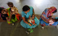 In this photo taken Wednesday, April 13, 2011, mothers feed their children at a ward for malnourished children, nine of the ten children are girls, at a government hospital in Morena in the Central Indian State of Madhya Pradesh. The starving girls point to a painful reality revealed in India's most recent census: Despite a booming economy and big cities full of glittering malls and luxury cars, the country is failing its girls. Early results show India has only 914 girls under age 6 for every 1,000 boys. The census in Morena showed that for every 1,000 boys only 825 girls in the district made it to their sixth birthdays, down from an already troubling 829 a decade ago.