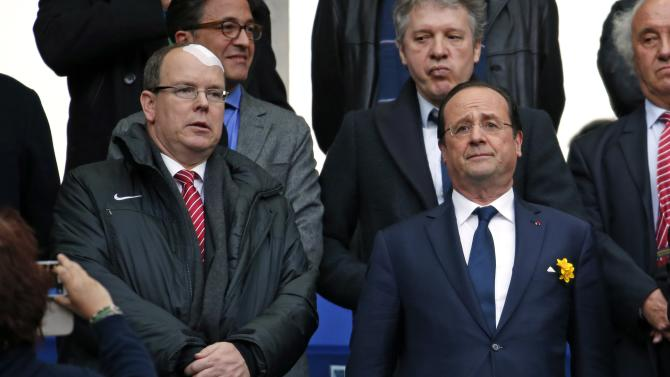 Prince Albert II of Monaco and French President Francois Hollande attend the Six Nations rugby union match between Ireland and France at the Stade de France in Saint-Denis, near Paris