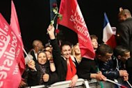 Supporters of Socialist Party (PS) candidate for the 2012 French presidential election celebrate at Place de la Bastille in Paris after the announcement of the first official results of the French presidential second round