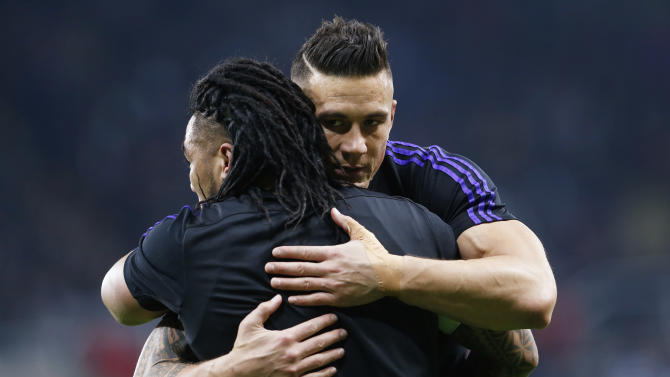 New Zealand's Sonny Bill Williams (R) hugs Ma'a Nonu before the game
