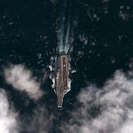 Handout photograph taken December 8 shows a satellite image from the DigitalGlobe Analysis Center of the Chinese aircraft carrier Varyag during it's second sea trial in the Yellow Sea. The United States, facing a rising China but a tighter budget, expects to station several combat ships in Singapore and may step up deployments to the Philippines and Thailand, a naval officer said