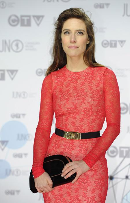 "Feist is hands down the best-dressed of the night. The ""Artist of the Year"" winner is stunning in a fitted red lace dress with a black and gold belt and matching clutch. THE CANADIAN PRESS/Sean Kilpat"