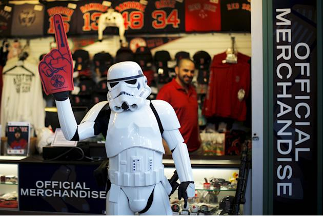 A person dressed as a Star Wars storm trooper character from the 501st New England Garrison wears a foam finger at a souvenir stand before the MLB baseball game between the Tampa Bay Rays and the Bost
