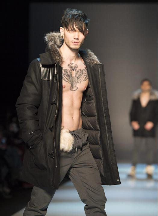A model walks the runway in the The Wild North show during Toronto fashion week in Toronto on Friday, March 27, 2015. (AP Photo/The Canadian Press, Frank Gunn)