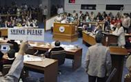 Senate security personnel call for silence as Philippine Supreme Court Chief Justice Renato Corona testifies during his impeachment trial in Manila. Corona denied he was a crook as he testified then dramatically walked out at his own trial