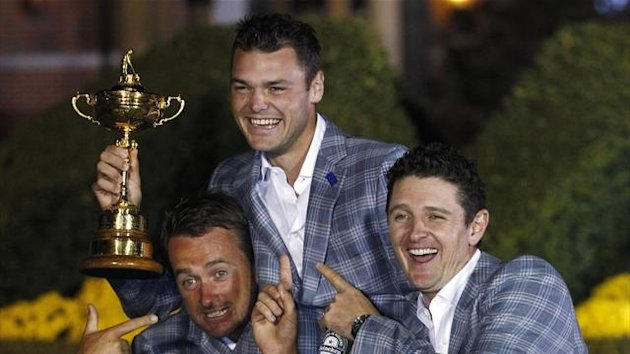 Team Europe golfer Martin Kaymer (C) of Germany holds the Ryder Cup with teammates Graeme McDowell (L) of Northern Ireland and Justin Rose (R) of England after the closing ceremony of the 39th Ryder Cup at the Medinah Country Club in Medinah, Illinois