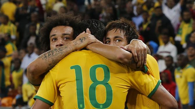 Brazil's Neymar (R) celebrates his goal against South Africa with Marcelo and Paulinho during their international friendly soccer match at the First National Bank (FNB) Stadium, also known as Soccer City, in Johannesburg
